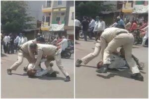 मास्क न लगाने पर पुलिस ने शख्स को सड़क पर पटक-पटक कर पीटा, बच्चा कहता रहा पापा को छोड़ दो; VIDEO VIRAL